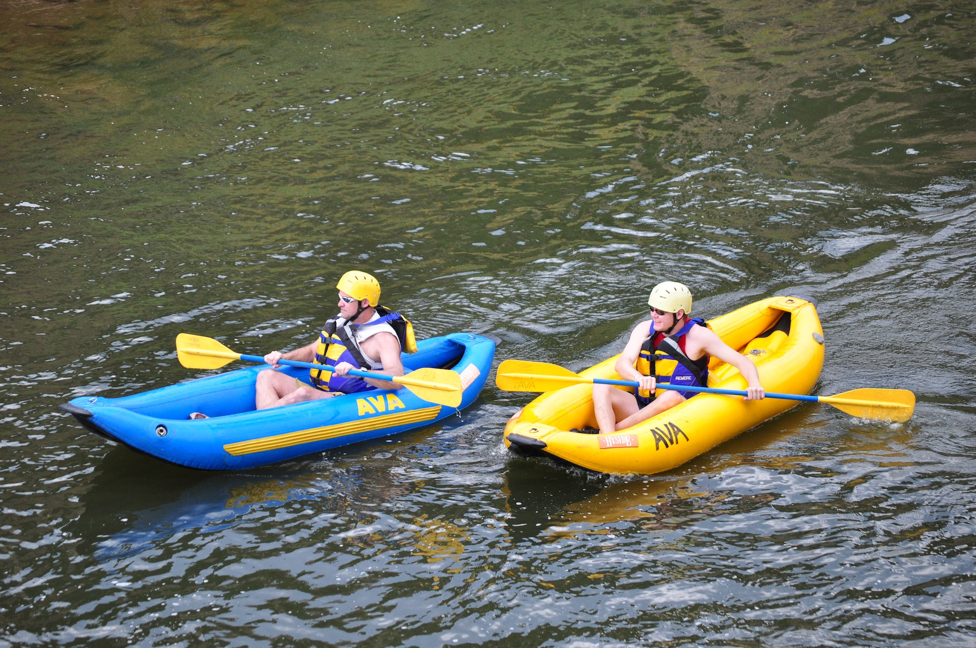 People in inflatable kayaks in river